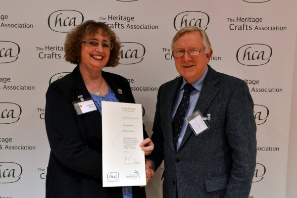 Louise receiving the award from Nick Carter, Marsh Christian Trust