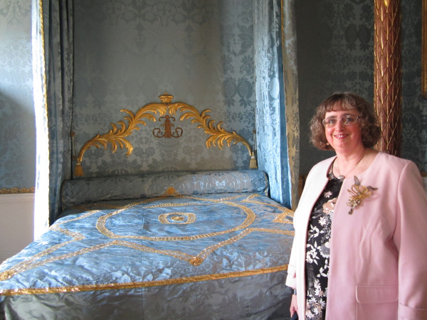 Louise standing next to the completed state bed at the launch on 24.3.17
